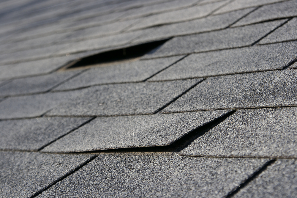 Loose shingles on a residential roof